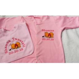 Babygro and bib set with Winnie the Pooh